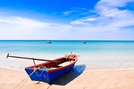 The Rowboat on the Chao Lao Beach  beach THailand. photo