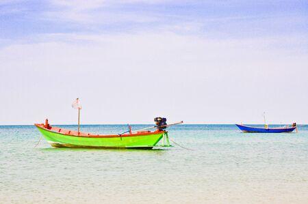 Fishing boats at sea at Chao Lao Beach, Thailand. photo