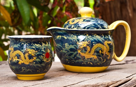 Teapot and teacup designs dragon in the morning. photo