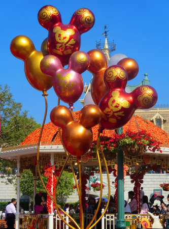 meet and greet: Victoria Harbour, Hong Kong - Feruary 2, 2014: Chinese-themed Mickey Mouse balloon decorations fronted the Town Square gazebo for the meet and greet section with Mickey Mouse and Miney Mouse during the second day of the Chinese New Year celebration.