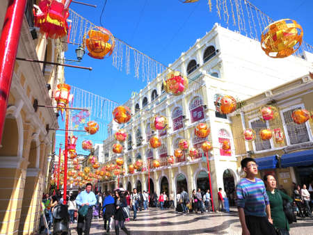 passageways: - February 1, 2014: Photo shows a busy day at Senado Square during the second day of the Chinese New Year. Tourist flock the streets from the town square down to the passageways leading to The Ruins of St. Paul Church. This place is less congested on norm