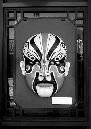 black giant mountain: Ngong Ping Village, Lantau Island, Hong Kong - Februay 3, 2014: Huge Chinese mask decorating the window of a store in Ngong Ping village.