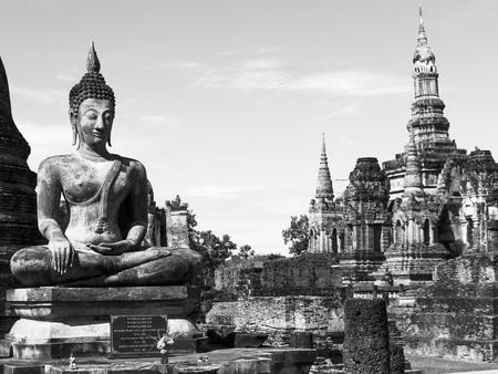 Vintage,Buddha meditation in Sukhothai of Thailand photo