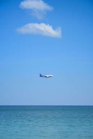 plane on  blue sky and sea photo