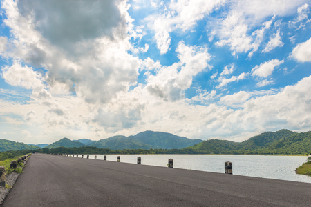 Long road travel with landscape of mountain with sky and cloud at Huay Prue reservior, Thailand Stock Photo