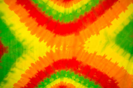 colourful tie dyed pattern on cotton fabric for background. Stock Photo