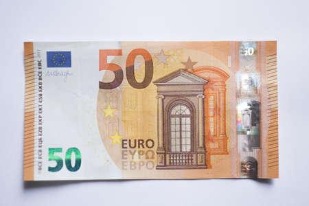 Banknot pięćdziesiąt euro na białym tle. Pieniądze waluty euro Zdjęcie Seryjne