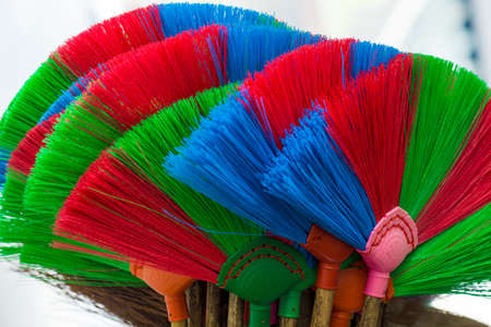 The colorful and patterns of plastic brooms.Soft focus