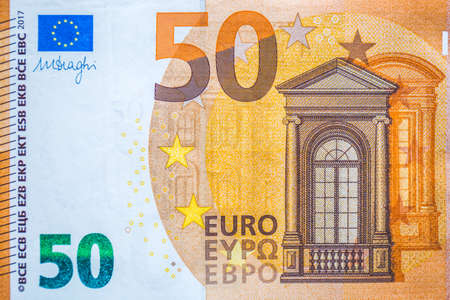 Closeup of the fifty euro banknote,Euro currency money Фото со стока