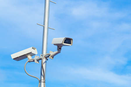 Two security cctv cameras on pole. Stock Photo