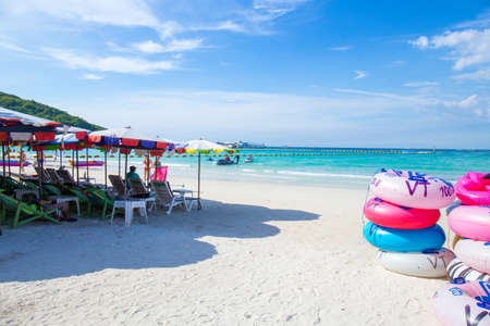 Chonburi, THAILAND -  22 February 2018 : Koh Larn, Tawaen Beach, where people go to relax, and beach trips on weekends.On the beach are tourists, chairs Beach umbrellas and sky with bright sea