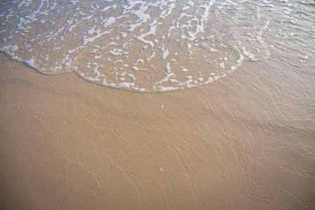 The movement of the waves on the sand is smooth and fine for  background, Stock Photo