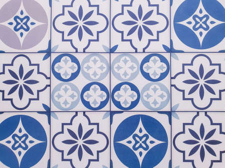 The pattern of the tile floor on the wall.Classic pattern Stock Photo