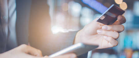 Business woman hand use credit cards and smartphones.Web banner. Stock Photo