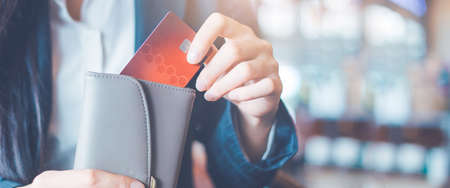 Business women hand Using a credit card, she pulled the card out of her wallet.Web banner.