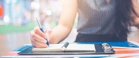 Woman hand writing on a notepad with a pen.Web banner. Stock fotó