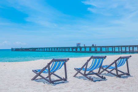 Beach chairs and bridges with sea and bright sky Stock Photo