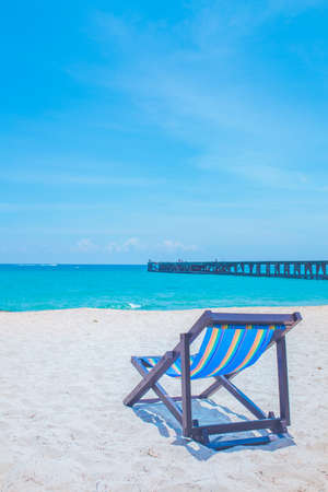 Beach chairs and bridges with sea and bright sky Stock Photo - 122844715