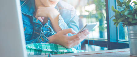 Women hand are using mobile phones.Web banner.