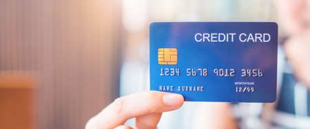 Woman hand holds a blue credit card.Web banner. Stock Photo
