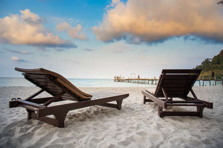 Beach chairs and wooden bridges on Ao Prao Beach, Ko Kood, Trat in sun rise. Stok Fotoğraf