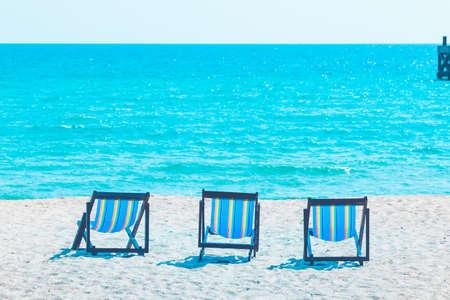2 beach chairs on the beach at the sea