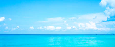 Floating clouds, fluffy colors against the blue sky and the sea.Web banner. Stok Fotoğraf