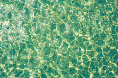 Sun light reflecting or sparkling glitter on water of sea or ocean. Stok Fotoğraf