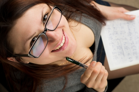 Attractive female student is preparing for exam photo