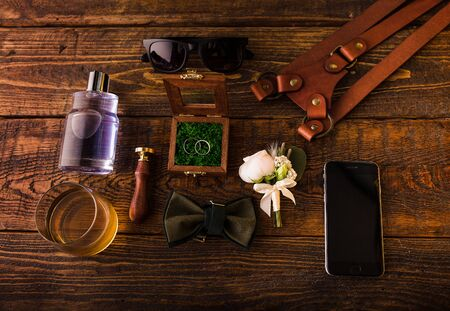Wedding groom's accessories layout in rustic style