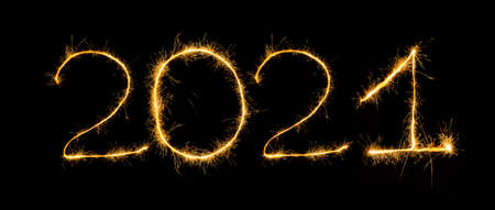 Happy New Year 2021 with sparklers on black background