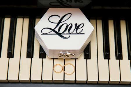 Wedding rings on piano keys .The photo taken of bride morning.