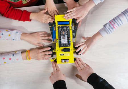 Children in a robotics lesson