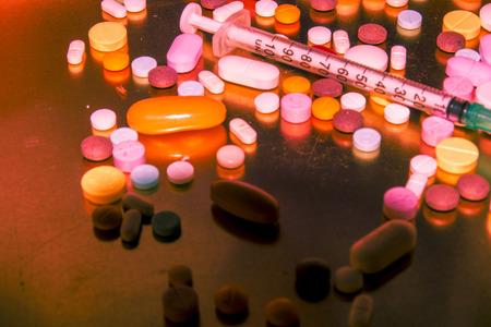 drug use and prohibited substances and syringe Stock Photo