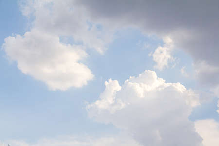 obscuring: Dense clouds gathered in the sky, obscuring the light from the sun. Stock Photo