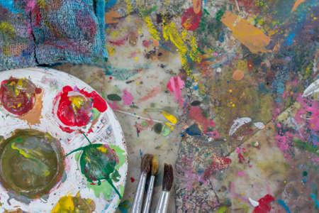 pans: A Paint brushes, paint pans.