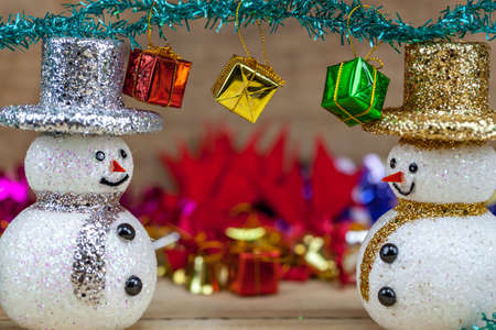Snowflakes are on a wooden floor with a gift box on the head Stock Photo