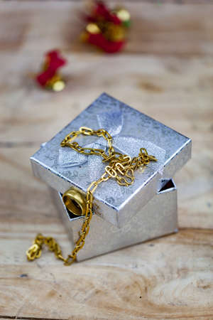 Jewelry, gold necklaces and gold rings put on gift boxes