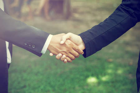 Handshake. It is a collective agreement to work. In the garden. Life style
