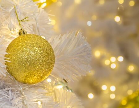 chirstmas: Golden ball on Chirstmas tree, the xmas decoration with bokeh background