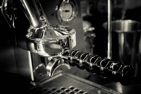 Close up of part of Espresso coffee machine in coffe shop (black and white tone)