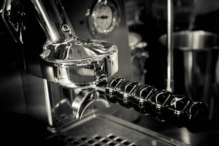 steel. milk: Close up of part of Espresso coffee machine in coffe shop (black and white tone)