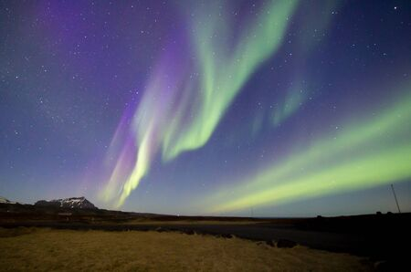 Aurora borealis with mountain background, northern lights in Iceland