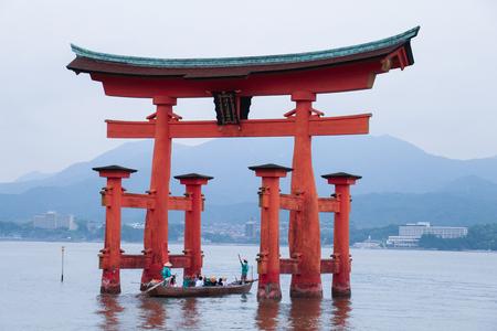 in low spirits: Miyajima, JAPAN - June 2015 : Itsukushima Shrine is a Shinto shrine on the island of Itsukushima , Miyajima , Japan. Best known for its floating torii gate. UNESCO World Heritage Site.