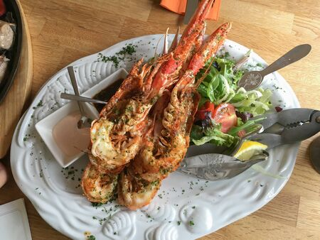 Whole Langoustine serve with salad and special sauce