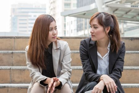 work life balance: two business women are discussing and share about their work life. They have sympathy for each other Stock Photo