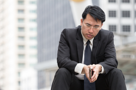 Stressed business man sitting with serious face and feel depressed 版權商用圖片