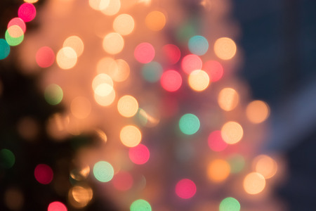 Defocused bokeh light background for Christmas and New Year Celebration
