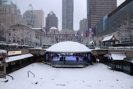 Vancouver, CANADA - 23 Feb, 2018 : Robson Square Ice Skate Ring in Winter. It has heavy snow.
