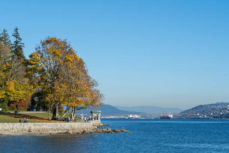 Stanley Park and seawall in Vancouver, Canada. It is largest urban park with beaches, trails, scenic seawall. It's a top attraction for tourist in Vancouver, British Columbia